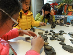 Inukshuk excitement (Canadian Dragon) Tags: 2017 bc canada chinese dschx5c february nanaimo vancouverisland balance concentrate concentration girls inukshuk learn learning make play playing rocks stack stones surprise winter