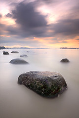 Storm's brewing (~ @lvin ~) Tags: longexposure sunset bw clouds rocks punggol ef1740mmf4l nd110 leefilters 06gnd 5dmkiii