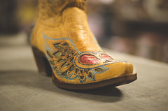David Beck - Swift Kick in the Ribs (David.Beck) Tags: red david leather fashion yellow vintage austin photography boot wooden cool cowboy texas tech boots beck bokeh tx allens hipster band style scene artsy independent uncool becks texmex davids southcongress cowboyboots uncool2 uncool3 uncool4 uncool5 uncool6 austiney