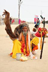 Sadhu with really long hair (kissoflif3) Tags: street old portrait people india man hair longhair oldman sadhu saffron sangam allahabad kesh kumbhmela sanyasi kumbhmela2013 vision:text=058 sadhuwithreallylonghair keshnikhaar