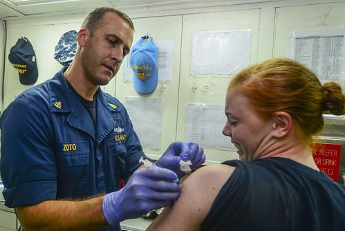 Sailor has flu shot aboard USS Monterey.