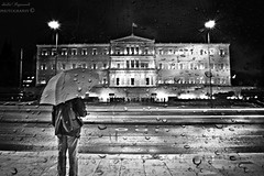 tearful lens.... (Love me tender .**..*) Tags: street people blackandwhite man rain greek photography town shots tripod parliament athens noflash greece syntagma dimitra umprella vouli absoluteblackandwhite mygearandme mygearandmepremium nikond3100 flickrstruereflection1 flickrsfinestimages1 flickrsfinestimages3 kirgiannaki