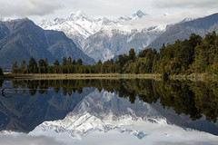 Mirror - Lake Matheson, New Zealand (explored) (Geee Kay) Tags: newzealand mountain lake mountains alps reflection reflections cook glacier mount southern foxglacier southernalps matheson lakematheson mountcook foxglaciernewzealand mounttasman wetreflection mountainreflection newzealandmountains newzealandmountain newzealandglacier