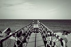 Distant horizon II (Matt Berger Photography) Tags: sea blackandwhite bw monochrome mono pier nikon horizon poland polska balticsea baltic nikkor gdask pologne nikond3200 batyk westerplatte baltyk pomorze mattberger d3200