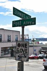 One Love (Adventurer Dustin Holmes) Tags: 2017 seattle seattlewa seattlewashington onelove sign signs graffiti postalley stewartstreet stewartst streetsigns streetsign