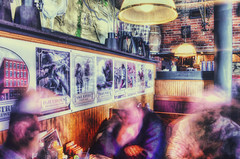 Beer and Spirits (Paul B0udreau) Tags: city canada ontario paulboudreauphotography niagara d5100 nikon nikond5100 photoshopcc buffalo unitedstates urban longexposure interior movement pearlstreetgrillbrewery bandodekvar posters nikkor1855mm tonemapped