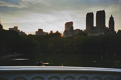 On The Bow Bridge (joeclin) Tags: northamerica unitedstates usa newyork ny manhattan nyc sunset thelake centralpark bowbridge skyline waterscape park uppereastside 1990s america