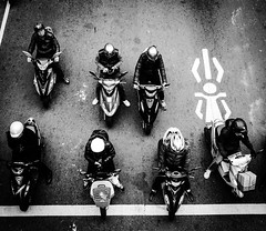 ...the moment our eyes met.. (dawn.tranter) Tags: dawntranter monochrome moment eyes blackwhite scooters taiwan street busy bridge traffic waiting