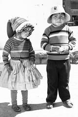 Peruvian Portraits, Puno (Geraint Rowland Photography) Tags: portraits childportraits candidportraits peruvianportraits islataquile laketiticaca puno peru southamerica blackandwhite blackandwhiteportraitphotography visitperu peruvianculture peruvianclothing cute hats childreninhats geraintrowlandphotography punopeople