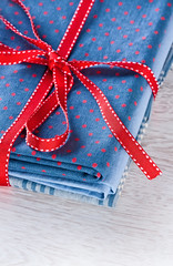 Blue fabric pile with red ribbon (♥Oxygen♥) Tags: fabric market heap clothing mall nobody bow ribbon dot many cloth bright pile assortment fashion sale color colorful blue art kit background textile roll dress mix red culture paint closeup texture cotton design set sew artistic beautiful material wooden darkblue polkadot
