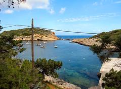 Paradise Cove. Ibiza. (ronsaunders47) Tags: sea boats coast sand cove ibiza shore portinatx
