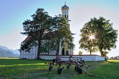 Hay tedder (Bart Kok) Tags: mountains church germany zonsondergang bomen zon kerk duitsland tegenlicht schwangau kerkhof hooischudder grasschudder