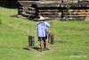 A Cambodian man carries Palm juice drink (pinnee.) Tags: ruins asia cambodia southeastasia cambodian cambodians khmer khmerpeople angkorwat temples siemreap freshjuice templecity kampuchea khmertemple templesofangkor khmersmile sugarpalm sugarpalmtree khmerarchitecture angkorarchaeologicalpark khmersmiles asiaimages sugarpalmjuice templesandruins southeastasiaimages borassus borassusflabellifer palmyrapalm cityoftemples kampuchean cambodiansmile angkorwatstyle អង្គរវត្ត coconutpalmsugar angkoriantemples nokorwat prasatangkorwat gulajava khmerppl skortnot នគរវត្ត palmsugartotaste palmjuicedrink sweetenedpalmsyrup waterinbamboocups palmfruitjuice đườngjava