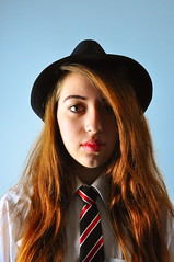 Trilby Tales. (Pranil.Raja) Tags: girls light portrait england people colour detail texture girl beauty face contrast portraits hair nikon uniform moody natural emotion bright zoom head expression flash young dramatic sharp indoors portraiture thinking emotional delicate coveredface lowiso nikond90