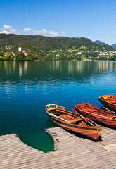 Rowing Boat Dock (Nomadic Vision Photography) Tags: slovenia turqoise rowingboat lakebled julianalps minidock jonreid beautifullake tinareid nomadicvisioncom