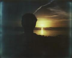 (Lidz.) Tags: light sunset sea sun film sol beach backlight analog polaroid atardecer mar seaside image carlos playa andalucia instant silueta spectra cdiz miau posta pz analgico analgic impossibleproject