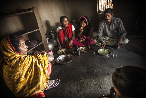 The mother looks on while the family eats lunch, Khulna, Bangladesh. Photo by Felix Clay/Duckrabbit.
