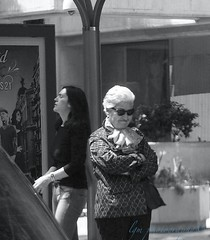 Two Women at a Bus Stop (Halcon122) Tags: madrid street bw sunglasses spain women raw afternoon candid streetphotography stranger busstop older unhappy younger