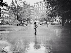 A Walk In The Rain (Joel Levin Photography) Tags: park urban blackandwhite bw usa newyork reflection philadelphia candid streetphotography philly allrightsreserved independencehall mobilephotography iphone5 thedefiningtouch thedefiningtouchgroup iphoneography deftouch editedanduploadedoniphone joellevin definingtouchgroup uploaded:by=flickrmobile flickriosapp:filter=nofilter