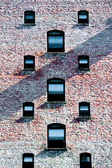 Vertical Window Patterns & Brick 2 of 2 (Orbmiser) Tags: windows building brick wall oregon portland nikon summmer reptition 28105mm d90 afd f3545 nikon28105mmf3545afd