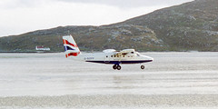 British Airways (Loganair) de Havilland Canada DHC-6 Twin Otter Landing At Traigh Mhor, Barra, Western Isles (Pigalle) Tags: uk canada beach scotland airport europe zoom kodak britain united great kingdom creativecommons western gb british ba airways barra westernisles ultra canoscan isles aps fs advantix hebrides airfield 4000 dehavilland outerhebrides mhor twinotter cockleshell dehavillandcanada havilland ultrazoom dhc6 attributionnoncommercialsharealike traigh vuescan ccbyncsa traighmhor gbzfp