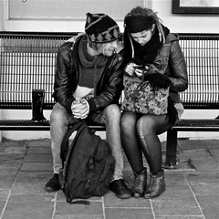 He, she and the device (Akbar Simonse) Tags: street boy people urban bw holland blancoynegro netherlands girl monochrome station bench bag square rotterdam zwartwit nederland streetphotography bank bn smartphone backpack tas dreads streetshot straat rotjeknor rugzak straatfotografie straatfoto akbarsimonse vision:text=0542 vision:outdoor=0759