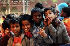Smile of Innocence (Sam Gupta Photography) Tags: christmas charity new xmas club canon children ride delhi group innocence donation biker purpose heavenly pleasure brawn motorcycling riders cause brd 2013 canonindia canoneos60d canonefs18200mmis samguptaphotography