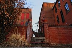 Looking In (Benjamin Sullivan) Tags: old blue windows red sky brick spring gate iron worn