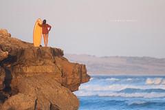 Australia (john white photos) Tags: ocean sea cliff nature water yellow rock female evening coast holding surf surfer australian australia coastal surfboard southaustralia eyrepeninsula