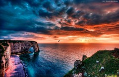 Etretat Dream (Riccardo Maria Mantero) Tags: travel sunset sea sky cliff france bird nature water colors rock stone clouds landscape town europe arch seagull ngc formation upper fr normandy etretat riccardo falesie geologic greatphotographers mantero afsnikkor1635mmf4gedvr potd:country=it