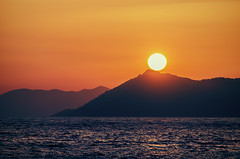 Last chance (Melissa Maples) Tags: sunset sea summer black water silhouette turkey evening nikon asia mediterranean sundown dusk trkiye nikkor vr afs fethiye  18200mm butterflyvalley  f3556g  18200mmf3556g kelebeklervadisi d5100