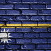 National Flag of Nauru on a Brick Wall