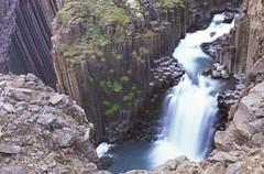 Water falls through Basalt Columns (rubberducky_me) Tags: iceland waterfall basalt column water film linhoftechorama