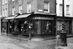 Olde London (Westhamwolf) Tags: london shop street back white city england verde co gun old