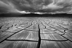 Desert Playa (Sarah Marino) Tags: deathvalley deathvalleynationalpark mojavedesert playa mudcracks crackedmud storm blackandwhite drama dramatic nationalpark california