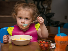 Hannah Dines: I'll be Serious Now (Entropic Remnants) Tags: pictures camera family children lens photography photo child image photos pics eating flash picture pic olympus images panasonic g5 photographs photograph dining f28 remnants entropic 1235mm fl600r dmcg5