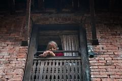 Bhaktapur, Nepal (dipu10dhaka) Tags: nepal window architecture women loneliness sad culture human tradition sorrow oldage bhaktapur dipu10dhaka