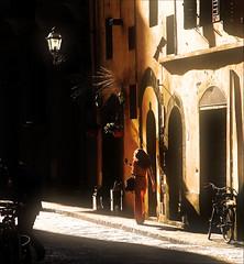 Backlight in Firenze (Banned from Explore) Tags: street italy woman topf25 girl bike bicycle juni lady backlight florence haze topf50 topf75 italia mood foggy 200 tuscany firenze faves 24 topf150 topf100 topf200 gegenlicht nextime seetrough watmooi mrtungsten62 frankvandongen