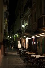 too early (Satirenoir) Tags: night restaurant cafe spain sidewalk cadiz