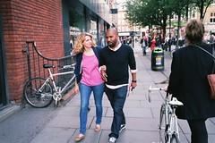Couple walking and talking, Soho (fabiolug) Tags: street leica pink people guy london film girl smile smiling bike 35mm walking couple candid soho streetphotography bikes rangefinder jeans summicron talking m6 westend leicam6 fujicolor candidphotography londonist filmphotography leica35mm leicam6ttl fujicolorpro400 35mmsummicronasph fujfilm pro400 leicasummicron summicron35mmf2asph fujifilmpro400 35mmf2summicronasph summicronm35mmf2asph leicam6ttl072 believeinfilm