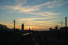 Bon voyage! (Mofromars) Tags: city sunset tower germany munich mnchen deutschland evening mood sonnenuntergang central tracks sigma zug trains blick gleise stimmung merrill abendstimmung sbahnstation dp2 hackerbrcke 2013