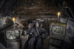 """He Watches And Waits (steiner2009 """"AKA Dr Dust """") Tags: old portrait urban abandoned portraits crust death tv rust alone robe antique decay spooky abandon forgotten abandonedhouse horror attic devil gasmask armchair derelict decayed decaying floorboards candels pictureframes televisions urbex"""