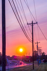 silhouetted electric pylon with power line at sunset (AgFineArtPhotography.com) Tags: road morning light sunset sky urban cloud sun tower industry nature station silhouette yellow electric metal danger sunrise evening high wire construction energy industrial technology power dusk background steel engineering cable row structure line pole pylon equipment electricity environment network tall electrical generation current watt transmission distribution volt supply voltage