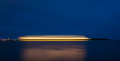 A ship arriving to the harbour (Antti Tassberg) Tags: lighttrail blue 15mm laiva yö longexposure reflection abstract minimal alus dark lowlight minimalistic night nightscape prime ship simplified vessel helsinki