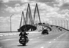 Fred Hartman Bridge Houston (WorldPixels) Tags: travel bridge bike clouds texas suspension transport bridges wolken harley transportation uitzicht vanishing davidson verkehr trucking bridging verkeer