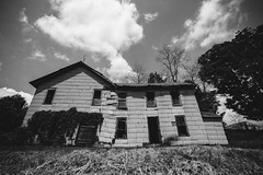 The House With Seven Windows (Amber Redfield) Tags: old trees wild sky blackandwhite bw cloud white house black building tree abandoned home broken nature monochrome architecture clouds canon buildings grey skies decay empty gray haunting desolate decaying deteriorate deteriorating sevendevils florenceandthemachine canoneos7d canon7d florencewelch amberredfield