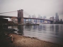 Morning Brooklyn Bridge (Guillermo Murcia) Tags: mist newyork apple water misty fog brooklyn america waterfront cloudy manhattan dumbo brooklynbridge eastriver capitaloftheworld iphone5 newyorkcityboroughs uploaded:by=flickrmobile guillermomurcia brooklynfilter flickriosapp:filter=brooklyn