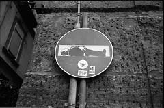 (Decadence) (Robbie McIntosh) Tags: leica blackandwhite bw film monochrome sign analog 35mm kodak trix streetphotography hc110 rangefinder bn summicron negative 400 analogue bungabunga m2 silvioberlusconi decadence biancoenero berlusconi argentique leicam2 dyi selfdeveloped pellicola kodaktrix400 analogico sunny16 nometering leicam filmisnotdead kodakhc110 hc110dilb autaut taxfraud leicasummicron35mmf20iv guessexposure leicasummicron35mmf2iv summicron35mmf20iv vision:text=0509 vision:outdoor=0917