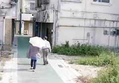 銀天街 歩くひとたち Okinawa-si, Okinawa (ymtrx79g ( Activity stop)) Tags: street color slr film japan analog nikon kodak 35mmfilm okinawa 135 沖縄 kodakgold100 傘 街 写真 銀塩 フィルム nikonnewfm2 沖縄市 nikonainikkor50mmf14 歩行走行 walkandrun umbrellaandparasol 201310blog okinawasi