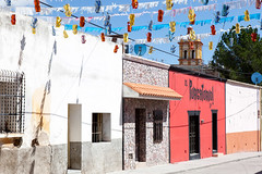 Street View in Charcas _9298 (hkoons) Tags: street cars mexico town decoration streetscene flags historic mining sanluispotosi charcas